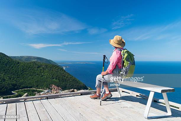 Woman hiking, Skyline, Cabot trail, Cape Breton, Nova Scotia