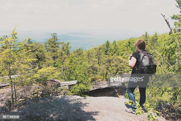 Woman Hiking Stands on Mountain Looking at View New York