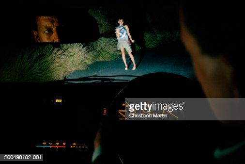 woman hitch hiking at night seen from car interior stock photo getty images. Black Bedroom Furniture Sets. Home Design Ideas