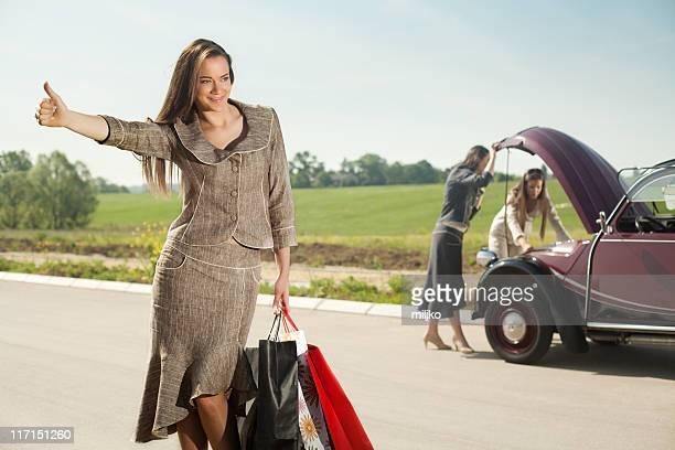 Woman hitchhiking