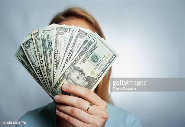 Woman Holding 20 Dollar Bills