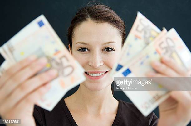 Woman holding 50 Euro banknotes