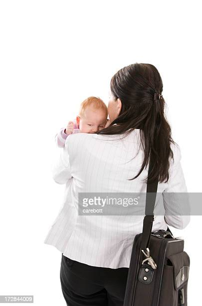 A woman holding a baby and carrying a professional bag