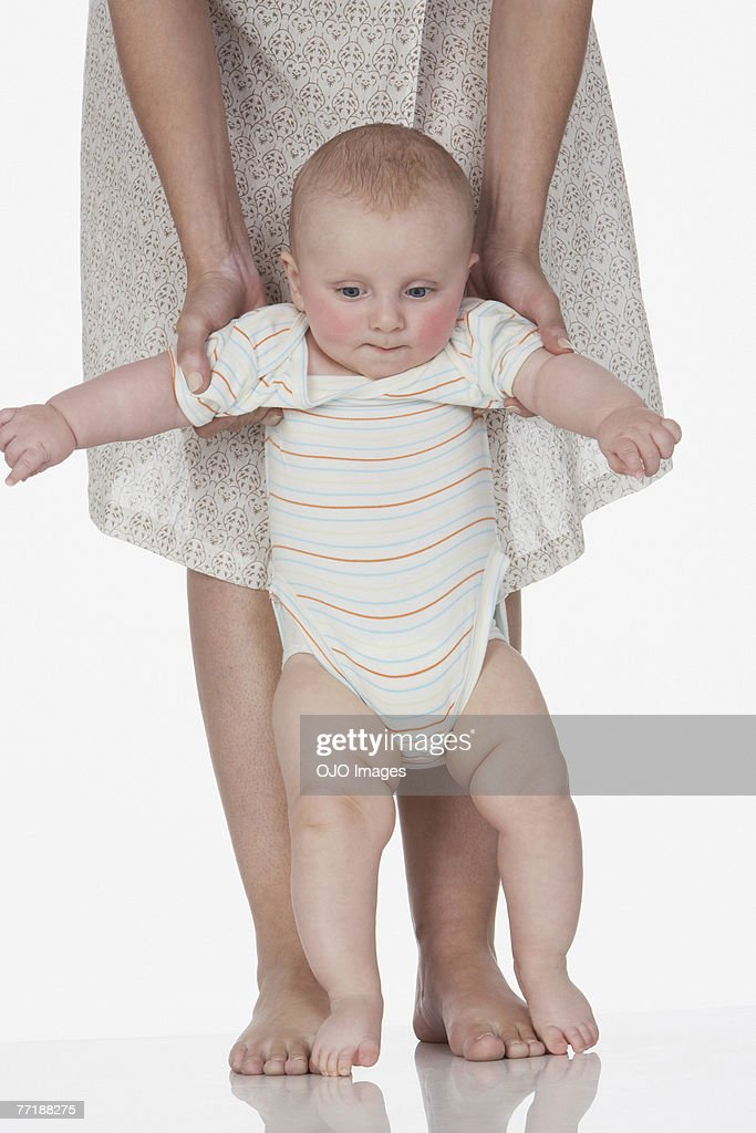 A Woman Holding A Baby Up Stock Photo | Getty Images