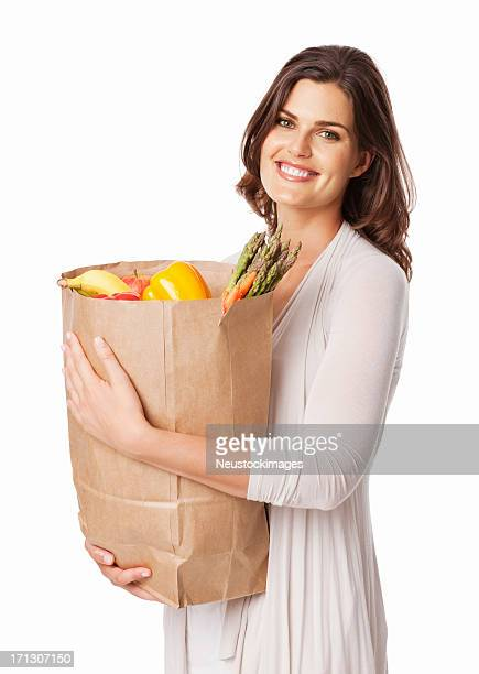 Woman Holding a Bag Of Fresh Groceries - Isolated