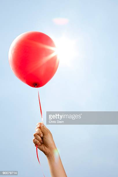 Woman holding a balloon
