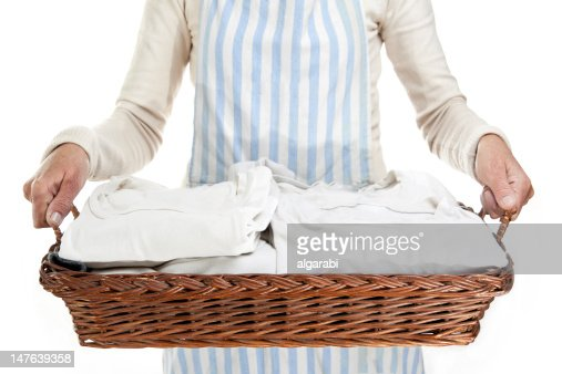 Woman holding a basket of clothes to iron, isolated : Stock Photo