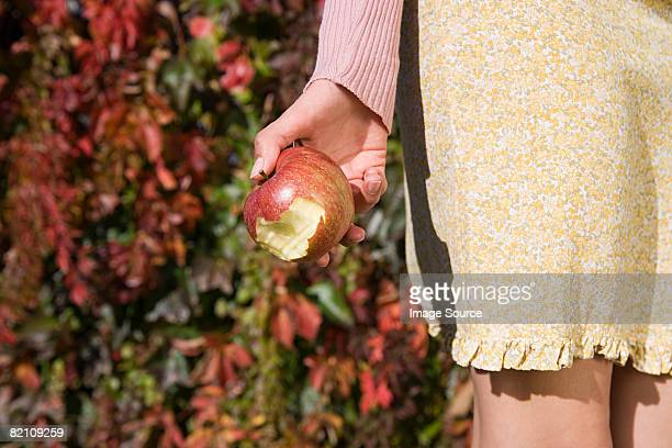 Woman holding a bitten apple
