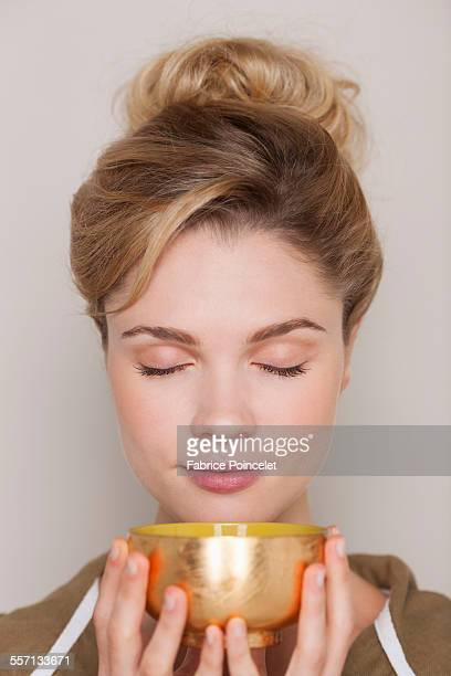 Woman holding a bowl of green tea