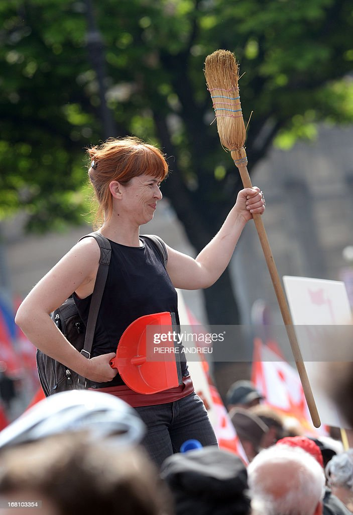 A woman holding a broom takes part in a demonstration on May 5, 2013 in Paris, called by Jean-Luc Melenchon, leader of Front de Gauche (Left Front) left wing party, to protest 'against the austerity, against the finance and to ask for a Sixth Republic'. When France's president Francois Hollande swept to power on May 2012 on a wave of discontent, he could hardly have imagined that a year later he would be the most unpopular president in modern French history. The broom refers to Melenchon's call for May 5 protest as a 'sweeping out'.