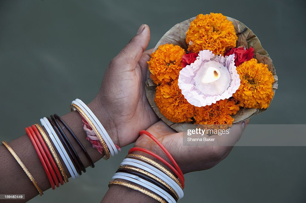Woman holding a candle offering at the Ganges : Stock Photo