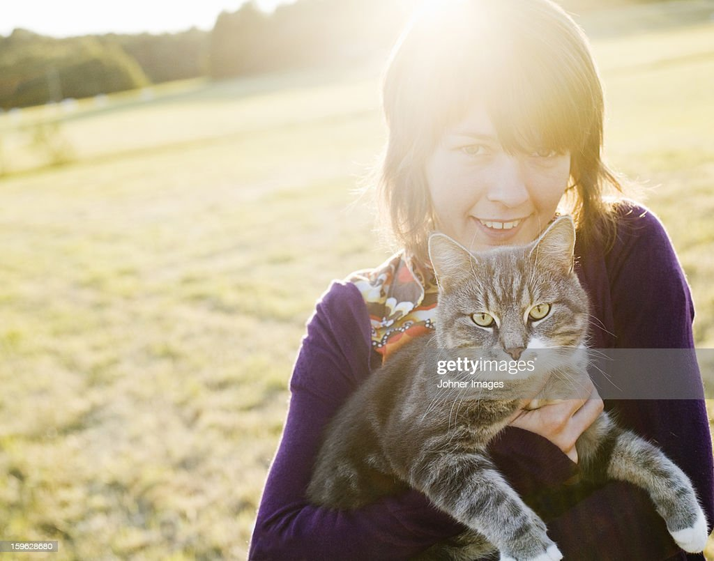 A woman holding a cat, Sweden. : Stock Photo