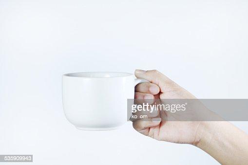 Mujer sosteniendo una taza de café. : Foto de stock