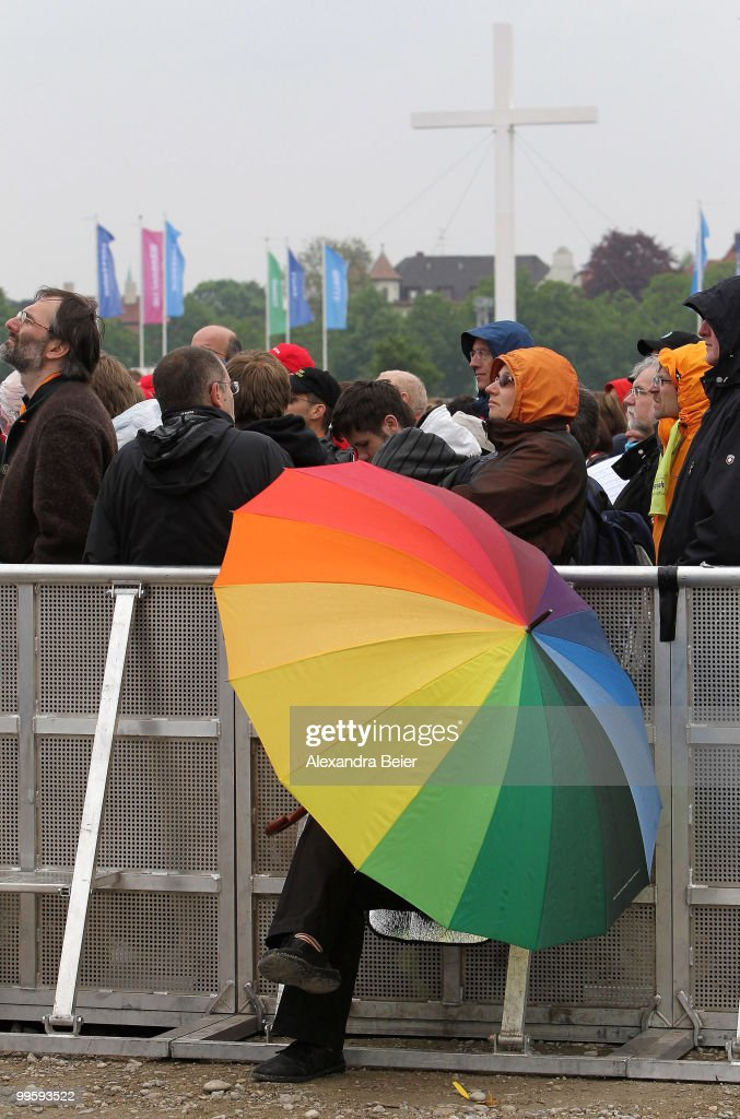 A woman holding a coloured umbrella attends the final holy mass at the last day of the 2nd Ecumenical Church Day (2. Oekumenischer Kirchentag) on May 16, 2010 in Munich, Germany. Thousands travelled to the southern German city to take part in the Church Day events held from May 12 to May 16, 2010.