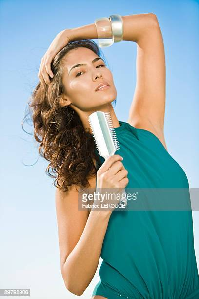 Woman holding a comb