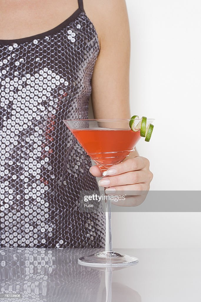 Woman Holding a Cosmopolitan Cocktail