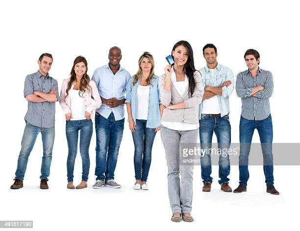Woman holding a credit card with a group of people