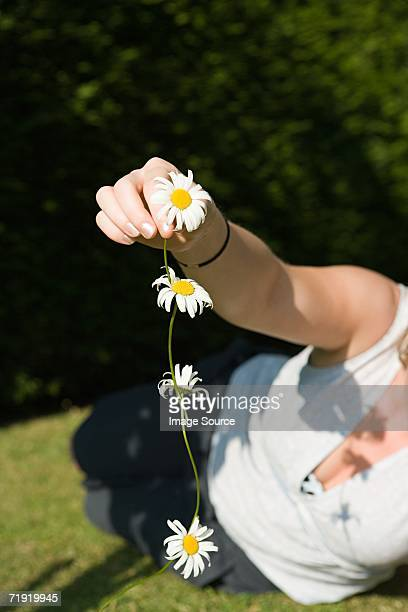 Woman holding a daisy chain