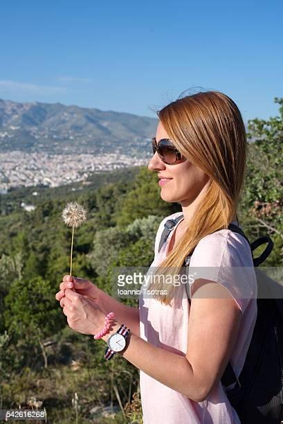 Woman holding a dandelion