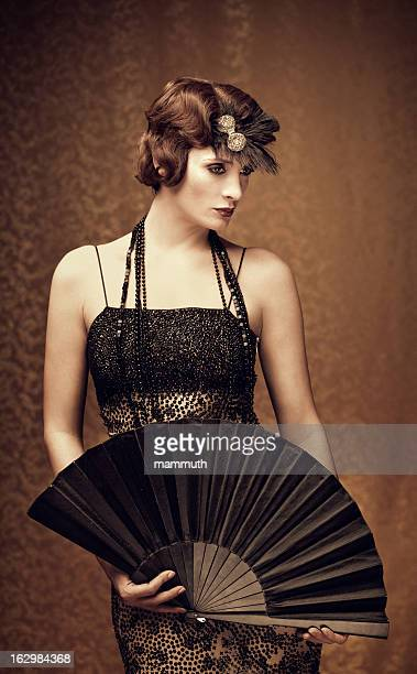 woman holding a fan - vintage style