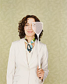 Woman Holding a Fly Swatter With a Dead Fly on it