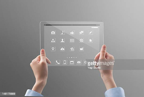 Woman holding a futuristic digital tablet