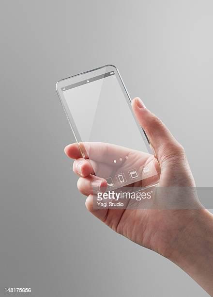 Woman holding a futuristic smartphone
