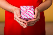 Young woman holding a gift box with a bow