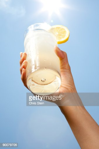 Woman holding a glass of lemonade
