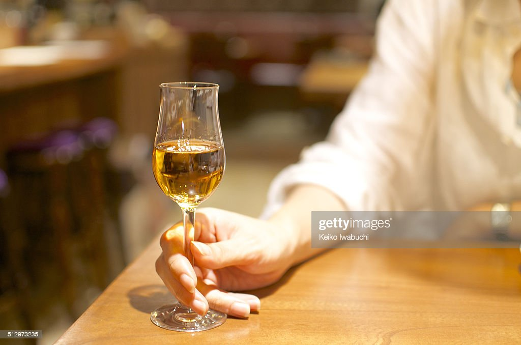 Woman holding a glass of sherry