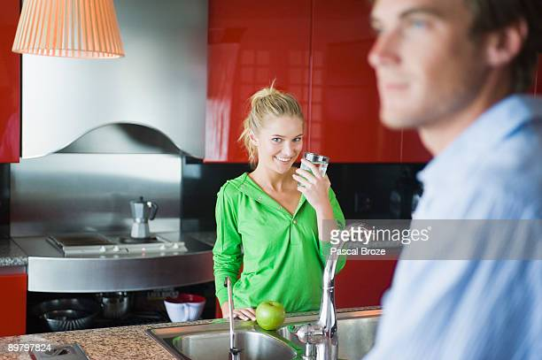 Woman holding a glass of water in the kitchen