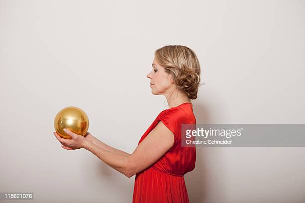 Woman holding a golden ball