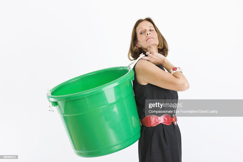 Woman holding a green plastic container