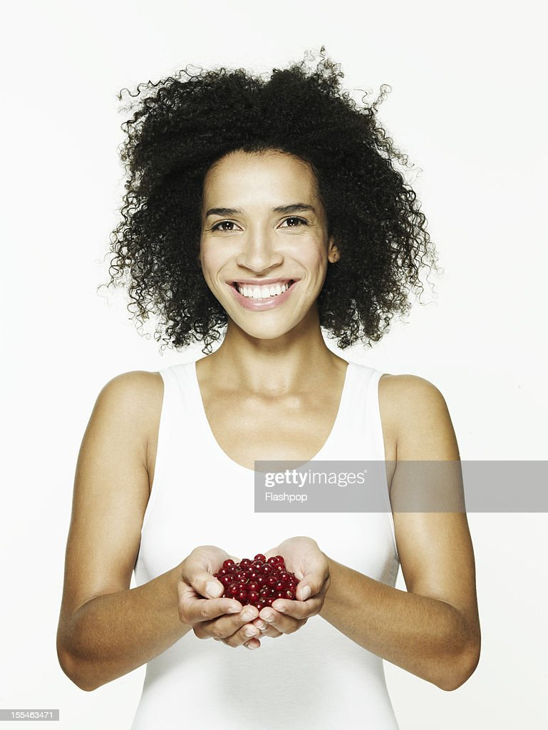 Woman holding a handful of red currants : Stock Photo