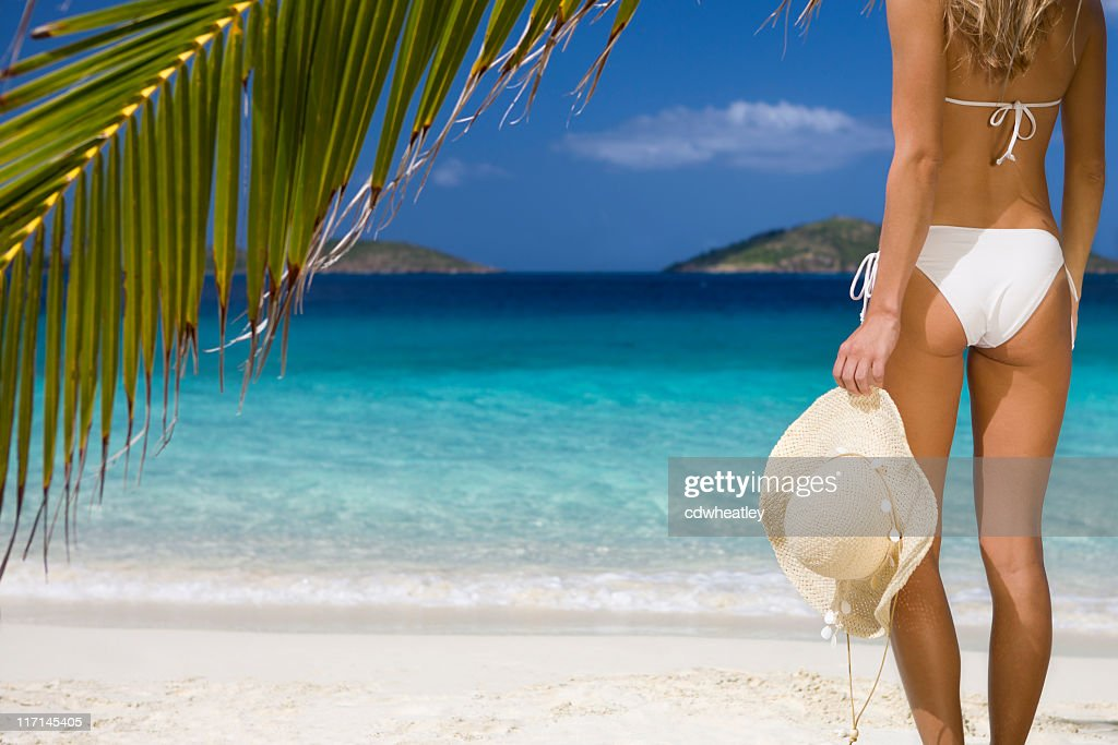 woman holding a hat at the Caribbean beach : Stock Photo