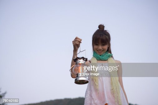 Woman holding a lamp  : Stock Photo