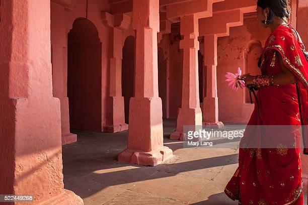 BODHGAYA BIHAR INDIA BODHGAYA BIHAR INDIA Woman holding a lotus flower in Mahabodhi Mahavihara temple Bodh Gaya Bihar India The Mahabodhi Temple is a...