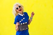 Woman holding a movie directors scene card
