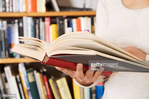 Woman holding a open book