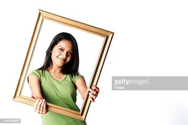 A woman holding a photo frame
