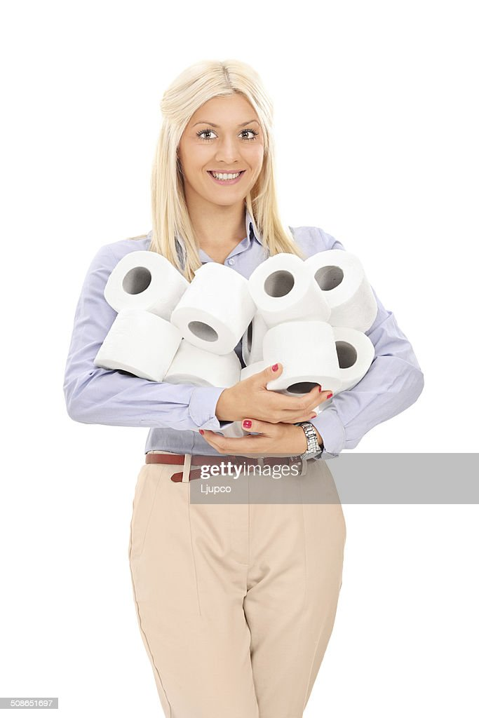 Woman holding a pile of toilet paper rolls : Stock Photo