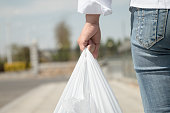 Woman holding a plastic bag