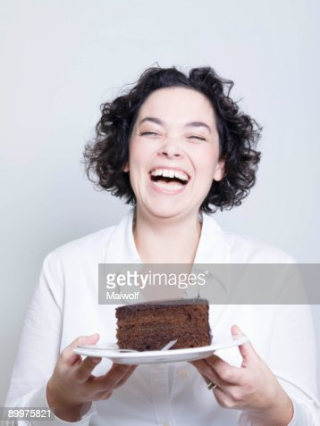 woman holding a plate of cake : Foto de stock