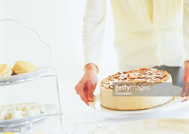 Woman holding a plate with cake