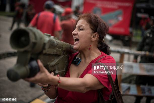 A woman holding a rocket launcher as part of military drills in Caracas on August 26 2017 Venezuela kicks off two days of military drills in response...