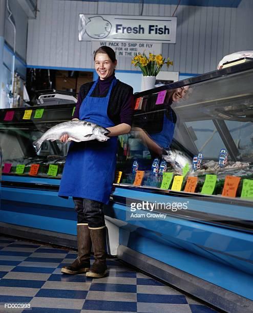 Woman Holding a Salmon