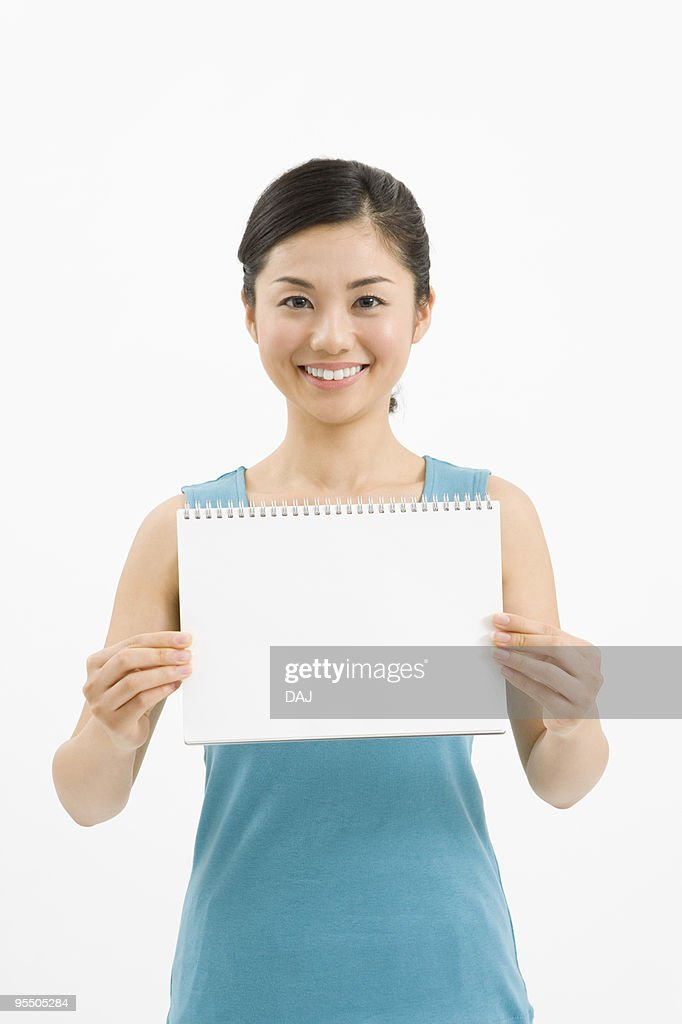 Woman holding a sketch book : Stock Photo