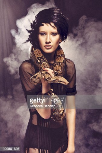 Woman holding a snake : Stock Photo