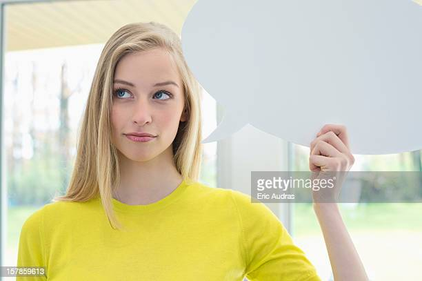 Woman holding a speech bubble