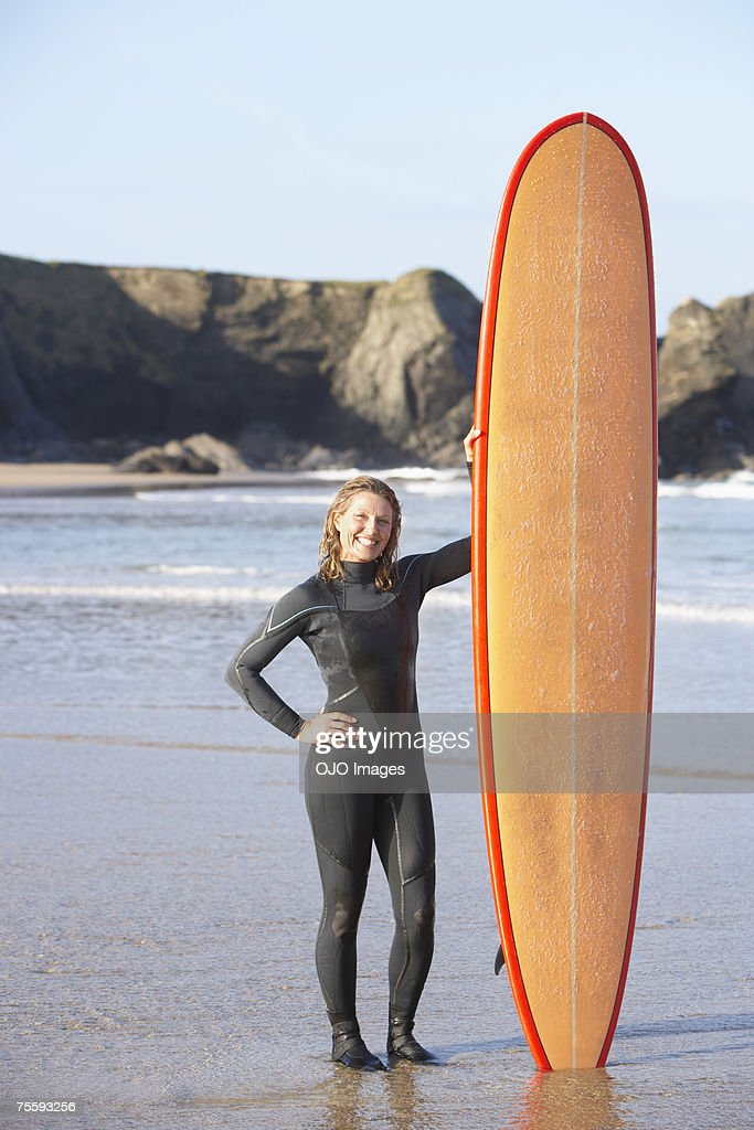 Woman holding a surfboard : Stock Photo